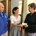 Bruce and Jill Schaefer give donation check to Connecticut Food Bank Representative
